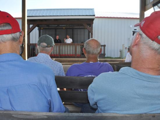 Farmers listen to a talk on the struggling ag economy -- followed shortly by a session on how to get rid of stress on the farm -- at the Farm Science Review in London, Ohio. (DTN photo by Emily Unglesbee)