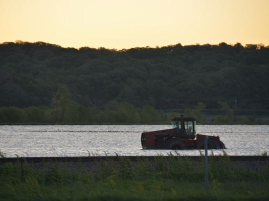 A tractor is surrounded by water near Hamburg, Iowa, as the Missouri River bottoms remain flooded. (DTN photo by Chris Clayton)