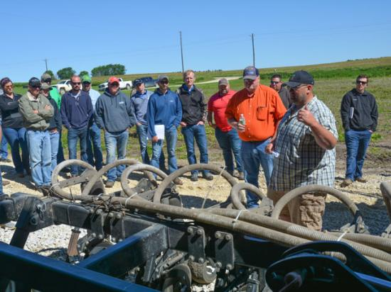 Loran Steinlage explains how his cover crop interseeder works during a field day June 13 at his farm near West Union, Iowa. (DTN/Progressive Farmer photo by Matthew Wilde)