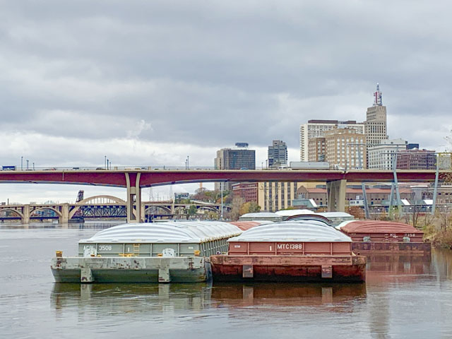 Barges waiting in downtown St. Paul in early November were eventually moved south ahead of the winter closure, many of them still empty. (Photo by Mary Kennedy)