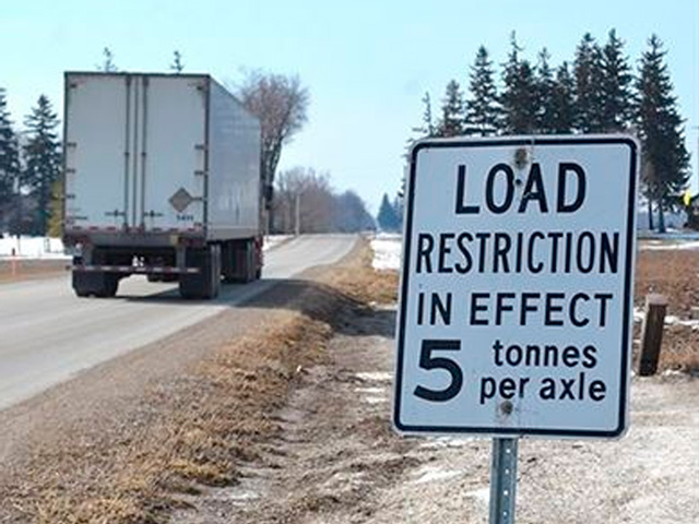Each year during the spring thaw, state, county and local agencies impose weight and speed restrictions to protect roadways from damage. The exact dates that seasonal load restrictions go into effect and are removed vary depending on annual temperature variations. Many states have already put restrictions in place, with more scheduled to start March 9. (Photo by the City of Coon Rapids, Minnesota)