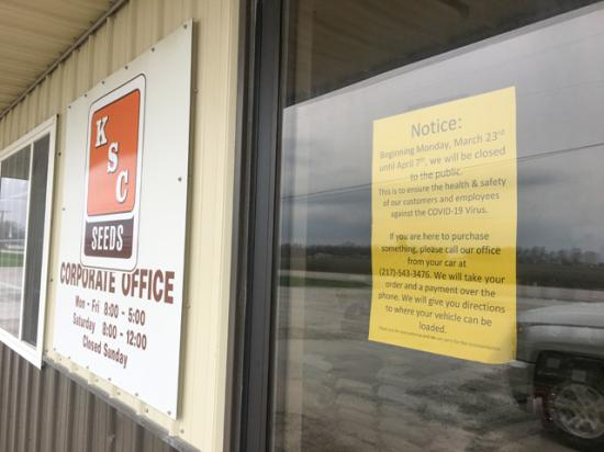 Signs to call and wait for hands-off delivery are not uncommon now in farm country. Kitchen Seeds in Arthur, Illinois, is among the businesses taking extra steps to deliver seed products safely. (DTN photo by Pamela Smith)
