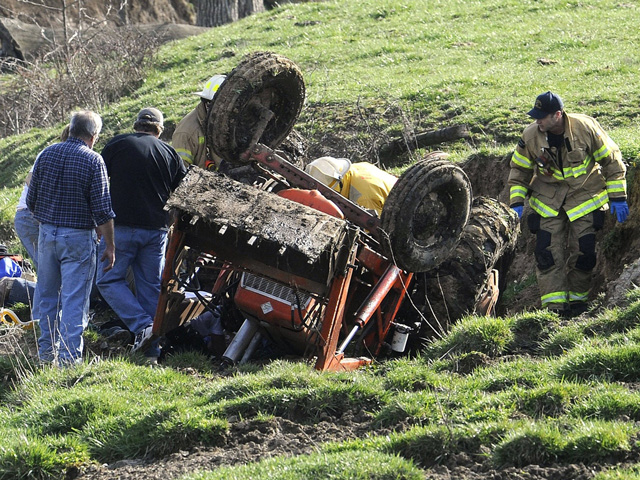 Discussing potential safety hazards and how to handle them before they actually happen can go a long way to prevent accidents like this rollover incident. (DTN file photo)