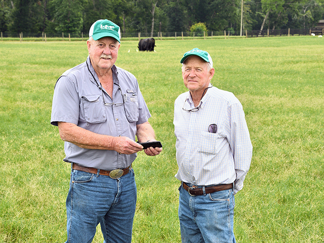 Lynn Brewer (right) manages Henry Griffin's (left) purebred Angus herd today, relying on practices that have proven their value over the years. (Progressive Farmer image by Becky Mills)