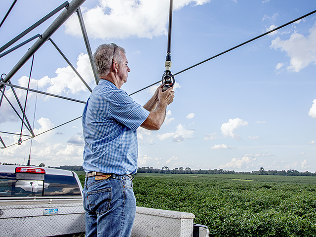Brian Ponder tapped into a pilot program to retrofit his sprinklers to lower pressures. He also added more efficient nozzles and pressure regulators. (Progressive Farmer image by Mark Wallheiser)