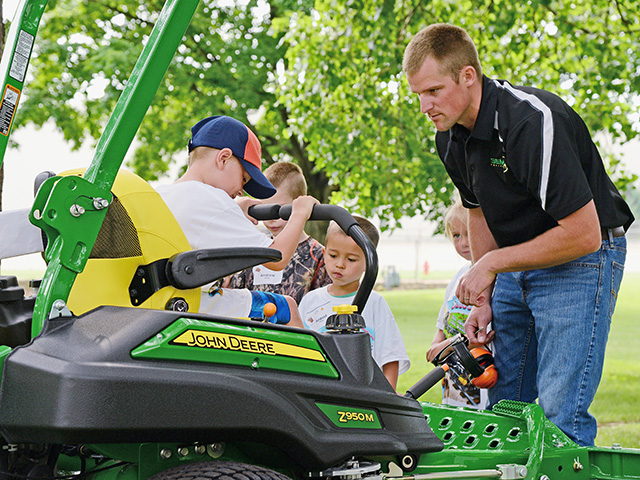 During a Progressive Agriculture Safety Day in Minnesota, participants learn why certain farm tasks are more appropriate for older teens and adults because of both their size and developmental ability. (Progressive Farmer image by Progressive Agriculture Foundation)