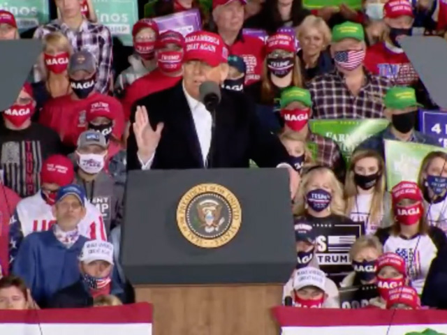 President Donald Trump speaks before a crowd at the Des Moines Airport on Wednesday evening. Trump talked frequently about aid to farmers and ethanol throughout the event. (DTN image from video livestream)