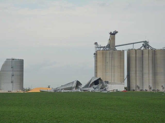 Several large bins, including one with corn, at Heartland Cooperative's Slater, Iowa, location were destroyed Monday by hurricane-force winds. All that's left standing are concrete silos. (DTN/Progressive Farmer photo by Matthew Wilde)