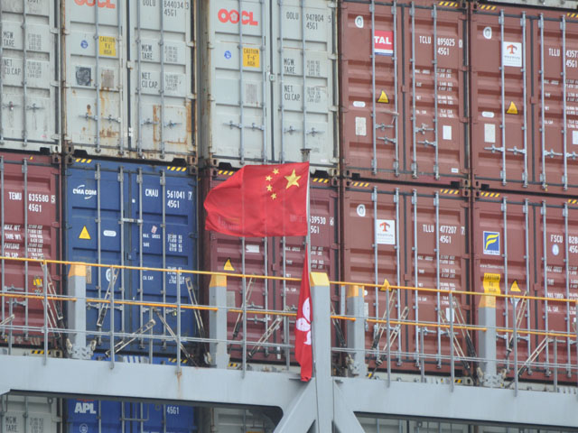 A Chinese flag blows in the wind on a ship loaded with cargo at the port of Long Beach, California, in 2018. Agricultural exports to China for some key commodities are rising, but the sales are way behind what is needed to reach the goals from the phase-one trade deal signed in January. (DTN file photo by Chris Clayton)