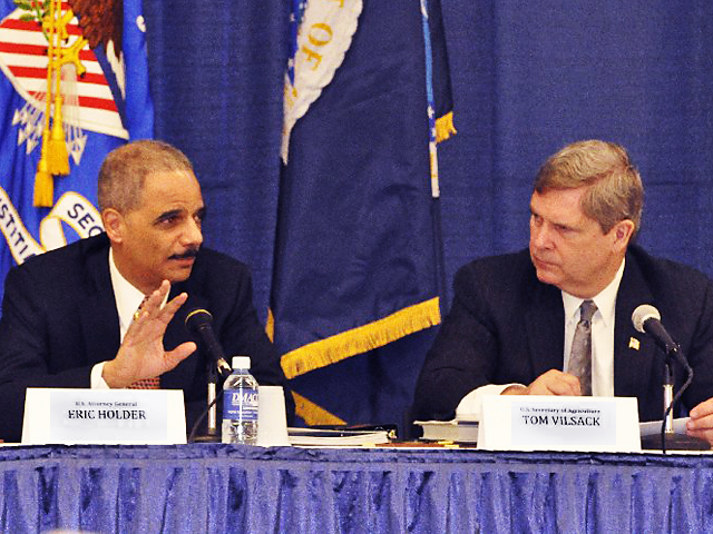 Tom Vilsack (right) listens to then-U.S. Attorney General Eric Holder speaking in 2010 when they both served under President Barack Obama. This time around, Vilsack will be striving to implement a different president's priorities (DTN file photo by Chris Clayton)