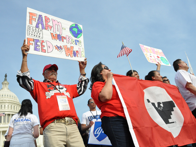 Farm workers in 2013 rallied at the U.S. Capitol calling for Congress to pass an immigration reform bill. At that time, a bill passed the Senate, but failed to advance in the House. This time around, a bill proposed by President Joe Biden could have a harder time passing in the Senate. (DTN file photo by Chris Clayton)