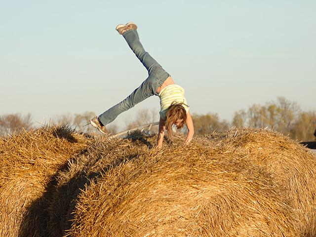 A farm is a great place to raise children, as nearly everything, including hay bales, is a playground. However, there are many hazards that farm kids face. (DTN/Progressive Farmer file photo by Jim Patrico)
