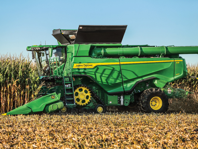 The new John Deere X9 Combine and CF Folding Corn Head can harvest up to 7,200 bushels per hour. (John Deere photo)