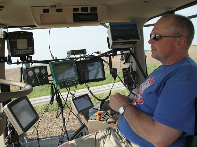 Modern technology and a work ethic allowed growers like Dean Werries to push corn planting to another level last week. The Chapin, Ill., grower sits surrounded by monitors. (DTN photo by Pamela Smith)
