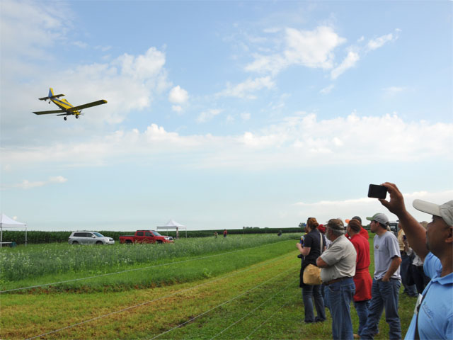 A plane demonstrates aerial seeding of cover crops as part of the Conservation Technology Information Center tour  of the Indian Creek Watershed in Illinois last week. (DTN photo by Chris Clayton)