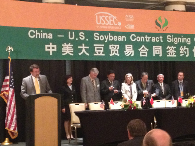 U.S. and Chinese dignitaries sign soybean contracts in this file photo from 2013. Soybeans, a $14 billion market in China, were hit with 25% tariffs late last week by Chinese officials. U.S. soybean futures fell, but soybean meal prices in China are ticking upward. (DTN file photo by Katie Dehlinger)