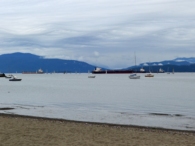 Vessels sit in Burrard Inlet near the Port of Vancouver in British Columbia. All facets of the grain pipeline will be tested in 2013/14. (DTN photo taken by Cliff Jamieson)