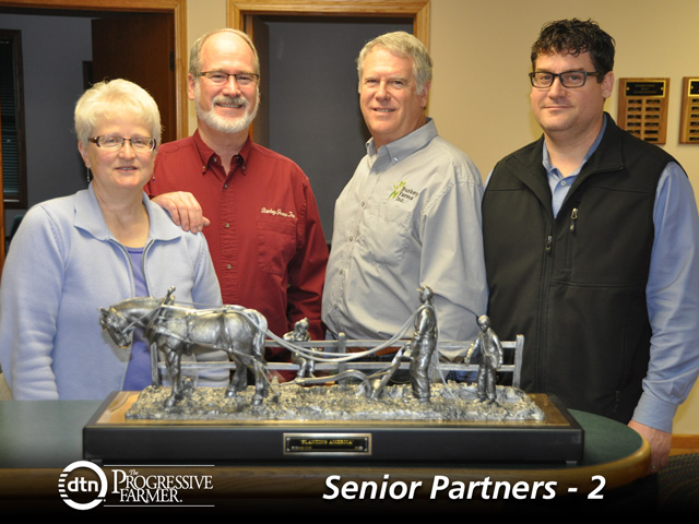 "The Burkey family of Seward County, Neb., formed a ""donor-advised fund"" to maximize their flexibility in tax-planning and increase the impact of their charitable donations. Pictured from left to right are Peg Burkey and her husband, Sid; Sid's brother, Tim; and Tim's son, Brant Burkey. (DTN photo by Anthony Greder)"