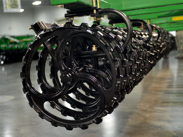 Instead of a basket at the end of its new primary tillage tool, the Short Disk, Great Plains uses cast iron rollers of its own design. Rollers on tillage tools are more common in Europe than in North America. (DTN/The Progressive Farmer photo by Jim Patrico)