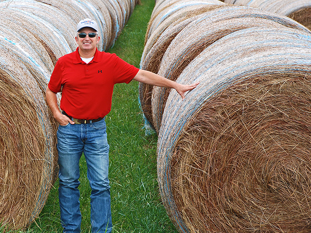 Oklahoma cattle producer Dax Burchett feeds 2,500 big bales of hay to his 800-head commercial herd each year. Cutting waste is a priority. (DTN/Progressive Farmer photo by Mark Parker)