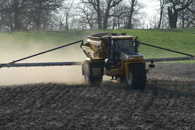 Dry fertilizer applicators went fast and furious this fall, but should they have waited until spring? (DTN photo by Jim Patrico)