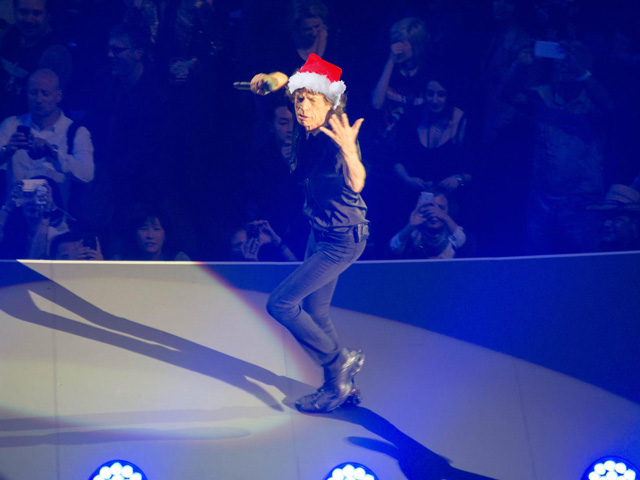 "No one could show more style than Mick Jagger in celebrating Cattle Christmas 2015, shouting and hissing his way through Santa's workshop with ""You Don't Always Get What You Want."" (Santa hat photo by Roger Blackwell; Mick Jagger photo by xiquinhosilva, CC BY 2.0; DTN photo illustration by Nick Scalise)"