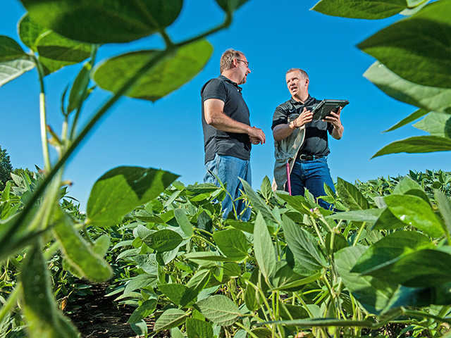 Farmer Kevin Malecek (left) relies on technology and crop consultant Jared Anez to make agronomic decisions. (Progressive Farmer photo by Steve Woit)