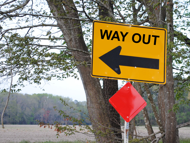 It can be daunting to hand over controls to a business you've built, so most owners establish a time line for gradual transition. (DTN photo illustration by Nick Scalise; road sign photo by Lee Cannon, CC BY-SA 2.0)