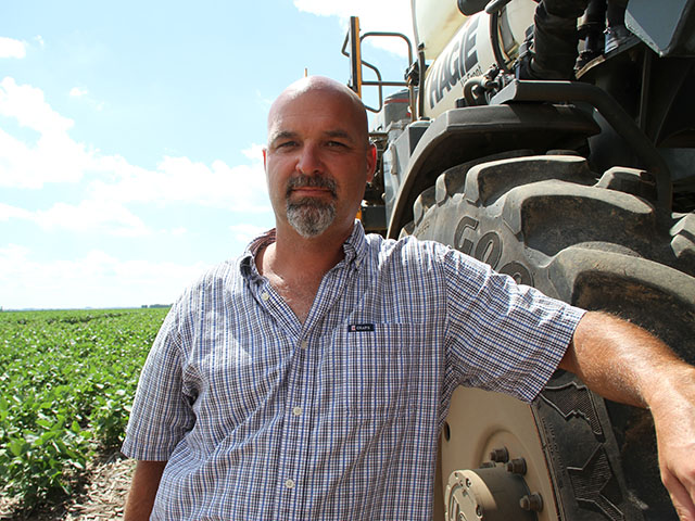 Recent approvals will allow Illinois farmer Kirk Martin to combine certain glyphosate herbicides into the tank as he sprays dicamba-tolerant soybeans. (DTN photo by Pamela Smith)