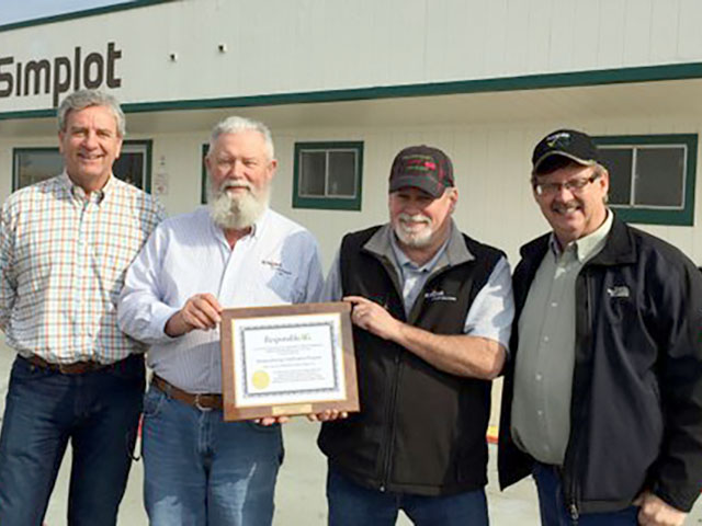 The Simplot Grower Solutions location in Madera, California, received its ResponsibleAg certification. At far right is Bill Qualls, executive director of ResponsibleAg. (Photo courtesy of Bill Qualls)
