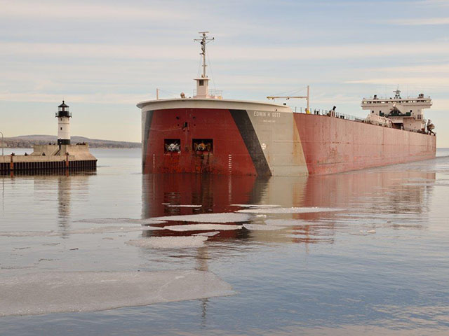 Pictured is the Edwin H. Gott, arriving early last year in the Port of Duluth-Superior. The Edwin H. Gott opened the 2016 Great Lakes shipping season for Duluth when she departed the port early on Tuesday morning, March 22, 2016, for Two Harbors to load iron ore pellets. (Photo by Paul Scinocca, courtesy of Duluth Seaway Port Authority)