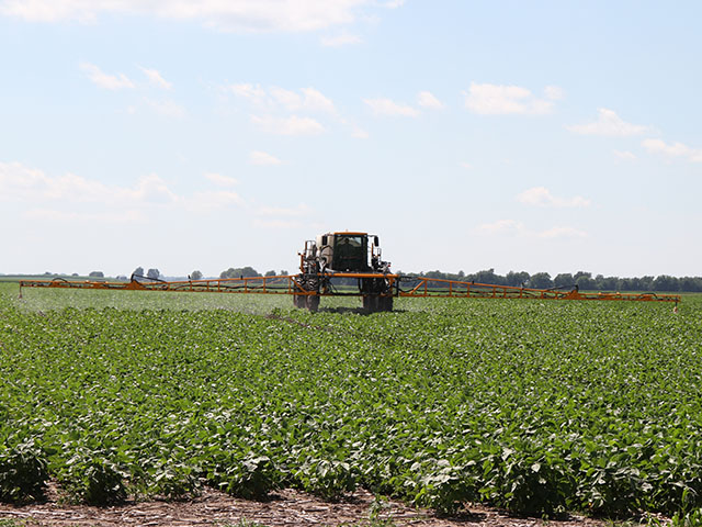 Monsanto is threatening legal action if Arkansas implements an in-season ban on dicamba herbicides, such as the ones being sprayed on this Illinois farm in 2017. (DTN photo by Pamela Smith)