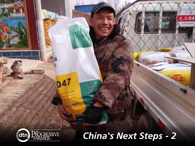 A Chinese grower displays his seed corn choice in a village of Shandong province. Pioneer is one of the multinationals having success marketing inputs. (Photo courtesy of DuPont Pioneer)