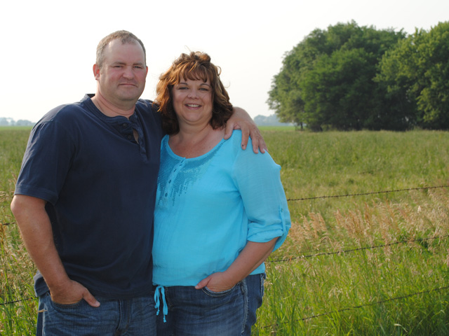 Nebraska hotline responder Michelle Soll (shown on land she farms with her husband, Mick) sees financial and emotional stress building, but not anywhere near 1980s levels. (Photo courtesy of Michelle Soll)
