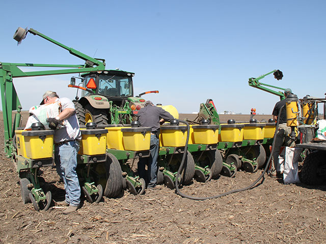 When should you consider planting soybeans instead if corn planting is delayed? (DTN file photo by Pam Smith)