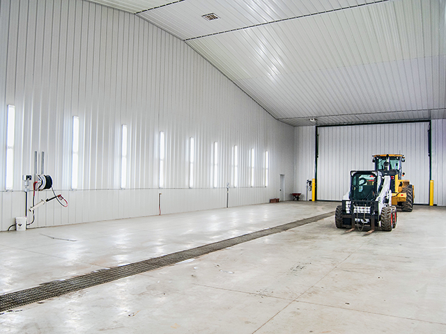 This 40-foot-wide x 125-foot-long wash bay helps Vaughn Zacharias and son Vance keep equipment clean even in winters on their Kathryn, North Dakota, farm. (DTN/The Progressive Farmer photo by Rob Lagerstrom)