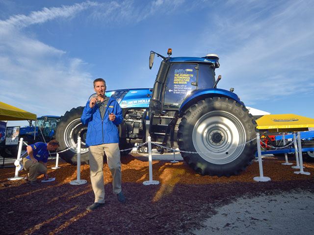 Existing technologies make a concept autonomous tractor possible now, Bret Lieberman, New Holland's vice president of North America, told journalists at an August farm show. Behind him is a T8 tractor capable of autonomous operation. (DTN/The Progressive Farmer photo by Jim Patrico)