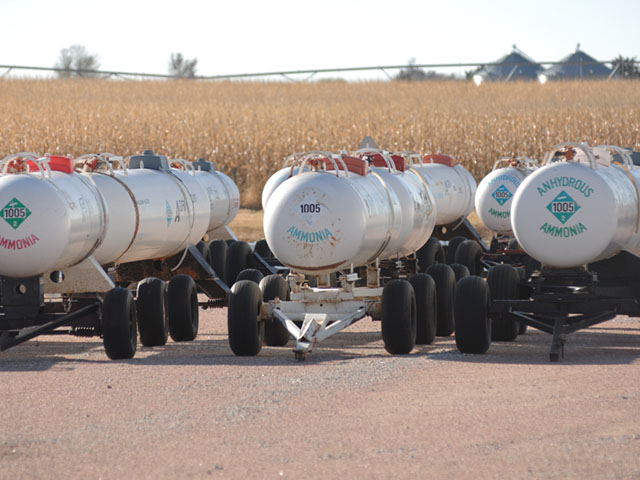 Anhydrous tanks lie in wait for the fall nitrogen season, but it's time to take a hard look at this practice. (DTN photo by Jim Patrico)