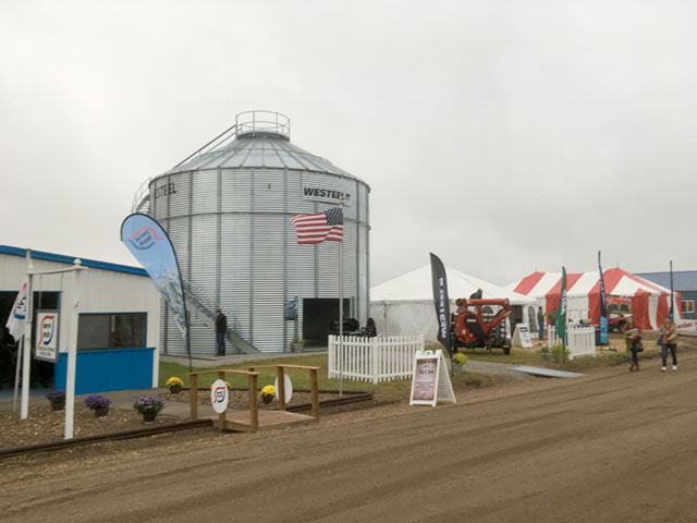 Yield prospects for corn still seem to be as murky as the skies over the Husker Harvest Days farm show near Grand Island, Nebraska. (DTN photo by Bryce Anderson)