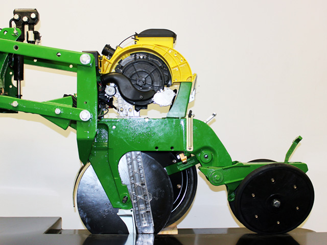 Precision Planting's SpeedTube high-speed planting system, pictured above mounted on a Deere planting unit, is at the center of a Department of Justice lawsuit to stop John Deere from purchasing Precision Planting. Deere has offered to license the technology out should the deal go through. (Photo courtesy of Precision Planting)