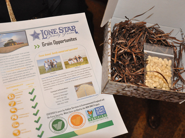 Lone Star Family Farms out of Texas put together a fact sheet and small package of white corn to give to potential grain buyers at an Organic and Non-GMO Forum this week in Minneapolis. (DTN photo by Chris Clayton)