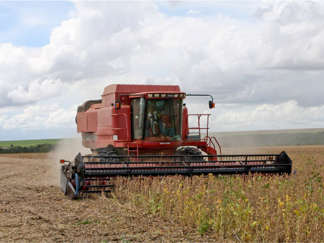 Combines moving through Brazil soybean and corn fields will get fuller much faster than a year ago, according to the latest CONAB estimates. (DTN file photo by Alastair Stewart)