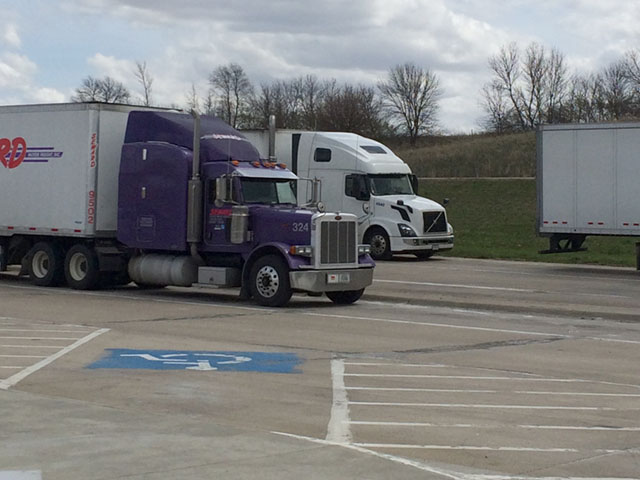 Semi-trucks parked at a rest stop along Interstate 35W. How will current proposed rulemaking of new truck regulations be affected by the White House regulatory freeze released on Jan. 20 and the Jan.30 executive order reducing regulations? (DTN photo by Mary Kennedy)