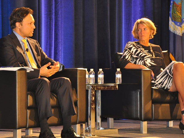 Rabobank executive Rajiv Singh and Land O'Lakes COO Beth Ford discuss the prospect of a depressed farm economy coupled with uncertain trade relations at the 2017 Ag Outlook Forum in Arlington, Virginia. (DTN photo by Emily Unglesbee)
