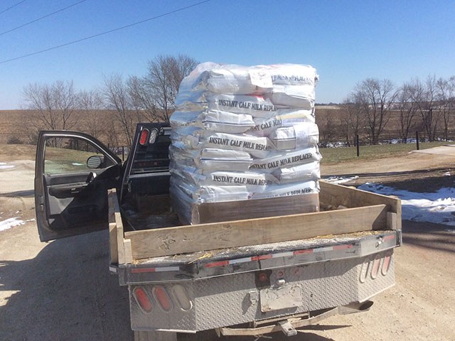 Farmers, ranchers, ag businesses, trucking companies and even service organizations have donated supplies and transportation to ag producers affected by High Plains wildfires. This pallet of milk replacer was donated by an Iowa 4-H club. (Photo courtesy of Mike Berdo)