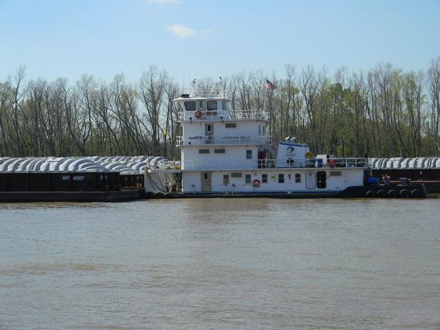 The Louisiana Belle and her crew busy parking barges along the Mississippi River near Destrehan, Louisiana, in late March. As flood waters move down river this week, barge traffic will be slow, or in some areas, stopped. (Photo by Mary Kennedy)