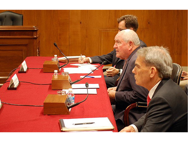 From left, USDA Budget Director and Acting Deputy Secretary Michael Young, Agriculture Secretary Sonny Perdue and USDA Chief Economist Robert Johansson at Tuesday's Senate Agriculture Appropriations Subcommittee hearing. (Photo by Zachary Silver)