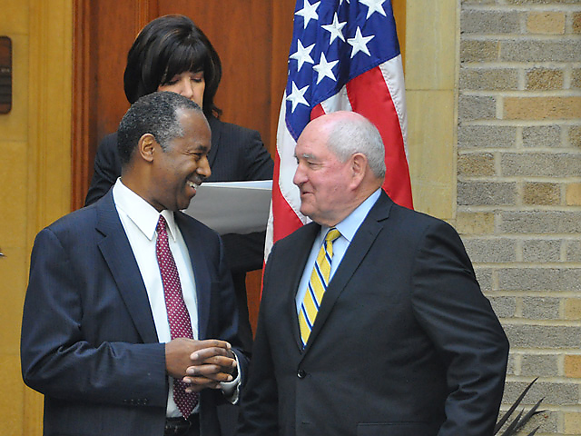 Ag Secretary Sonny Perdue greets Ben Carson, the secretary of Housing and Urban Development and a member of Trump's new Ag & Rural Prosperity Task Force, led by Perdue. (DTN photo by Emily Unglesbee)