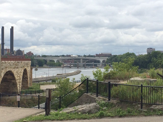 Pictured in the background of this photo is the rebuilt I-35W bridge, now known as the I-35W St. Anthony Falls Bridge that spans the Mississippi River in downtown Minneapolis, Minnesota. The original bridge collapsed 10 years ago on Aug. 1, 2007, sending the center of the channel span over 100 feet into the Mississippi River below, killing 13 people and injuring 145 others. It is a miracle that so many of those people who had been on the bridge when it collapsed survived that fall. (DTN photo by Mary Kennedy)