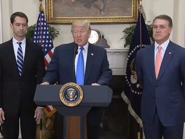 President Donald Trump endorses the RAISE Act while flanked by the bill's makers, Republican Sens. Tom Cotton of Arkansas, left, and David Perdue of Georgia. (Screenshot of White House video)